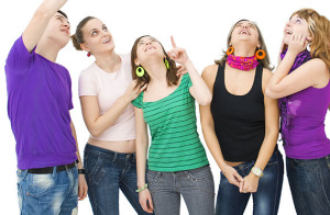 group of teenagers looking up and pointing towards something